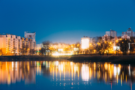 residential construction: Night View Of Urban Residential Area Overlooks To City Lake Or River