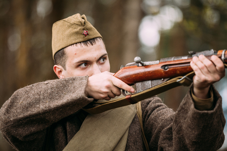 Pribor, Belarus - April 23, 2016: Potrait Of Young Re-enactor Dressed As Russian Soviet Infantry Soldier Of World War II With Rifle Weapon