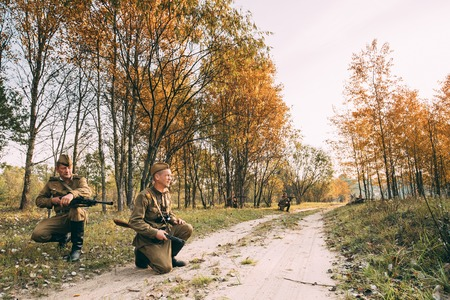 reenactmant: Teryuha, Belarus - October 2, 2016: Group Of Unidentified Re-enactors Dressed As Soviet Russian Red Army Infantry Soldiers Of World War II Marching Along Forest Road At Autumn Season.