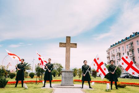 Batumi, Adjara, Georgia - May 26, 2016: Young men in Georgian national dress holding