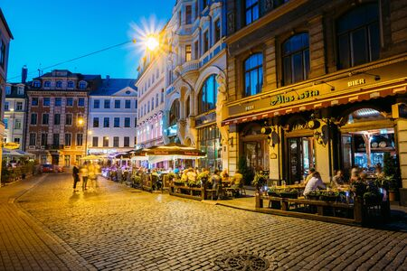lido: Riga, Latvia. People Resting In Street Cafe Restaurant In Old To Editorial