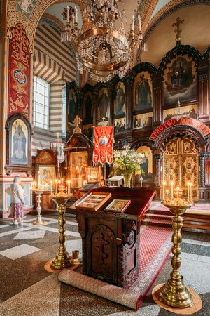 Vilnius Lithuania. Lectern Analogion With Two Icons For Veneration