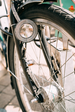 Close Up Of Bike Headlight And Wheel Of Bicycle On Street. Bike Stock Photo