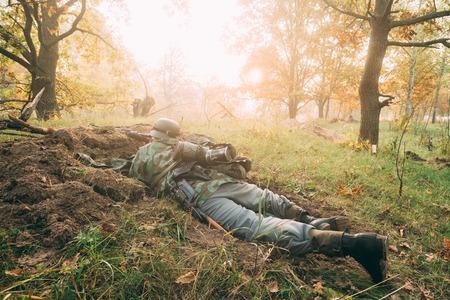 reenactmant: Re-enactor Dressed As German Wehrmacht Infantry Soldier In World