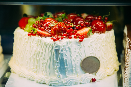 Sweet Cake With Currant And Strawberry Berries On Top In Pastry