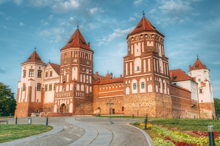 Mir, Belarus. Mir Castle Complex On Blue Sunny Sunset Sky Background Stock Photo