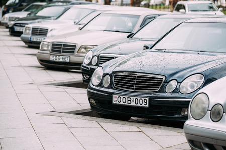 e 27: Batumi, Georgia - May 27, 2016: Different Cars Mercedes-Benz E-Class W210 And W211 Parked In Row In Street on Summer Day.