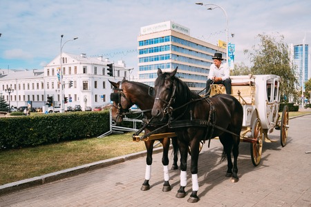 the coachman: Minsk, Belarus. Holiday carriage drawn by two horses, controlled