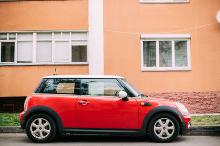Red Color Car Mini Cooper Parked On Street Near Residential House Editorial