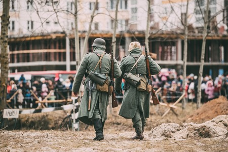 reenactment: Unidentified Re-enactors Dressed As German Infantry Wehrmacht soldier Stock Photo
