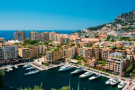 Yachts moored near city Pier, Jetty In Sunny Summer Day. Monaco, Stock Photo