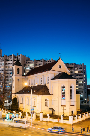 Minsk, Belarus. Evening Night View Of Cathedral of the Holy Apostles Sts Peter and Paul On Illuminated Nemiga Street. Editorial
