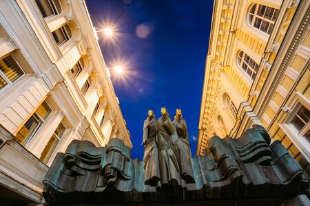 Vilnius Lithuania. Close Three Muses Sculpture Of Lithuanian National Drama Theatre Building, Main Entrance, Blue Evening Sky