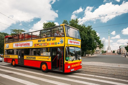 Riga, Latvia. Touristic Bus For Sightseeing In Kalku Street With Editorial