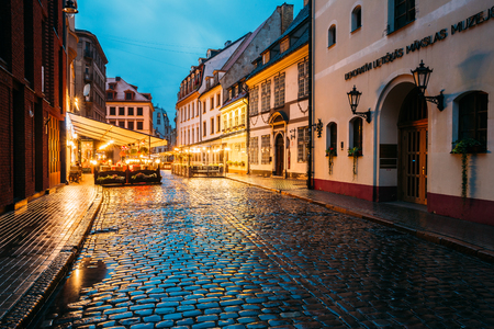 outdoor lighting: Riga, Latvia - July 3, 2016: The Museum Of Decorative Arts And Design MDAD And Cafe In Lighting At Evening Or Night Illumination In Old Town In Skarnu Street