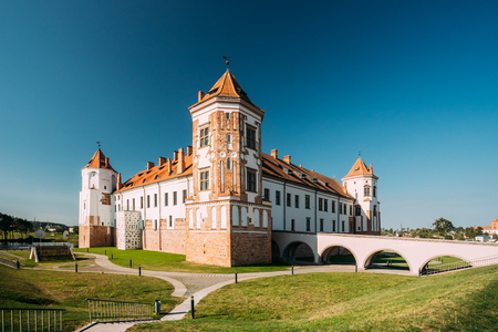 feudalism: Mir, Belarus. View Of Old Towers Of Mir Castle Complex On Blue Sunny Sky Background. Architectural Ensemble Of Feudalism, Ancient Cultural Monument, UNESCO Heritage. Famous Landmark In Summer Stock Photo