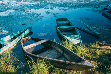 Abandoned Old Wooden Fishing Boats In Summer Lake Or River. Beautiful Summer Sunny Day Or Evening. Forsaken Boat. Russian Nature Stock Photo