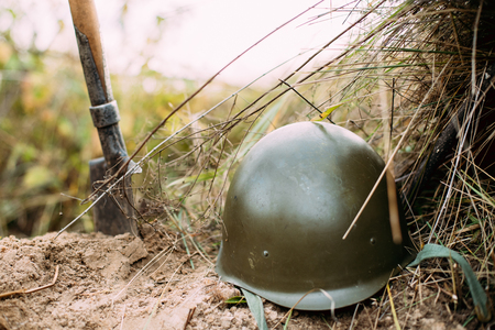 reenactment: Metal Helmet Of Infantry Soldier Of Soviet Russian Red Army During