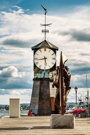 navigational light: Oslo Norway. Close Top Part With Big Clock Of Old Lighthouse At