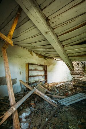consequence: Interior Of Ruined Abandoned Country House With Caved Roof, Evacuation Zone After Chernobyl Disaster Stock Photo