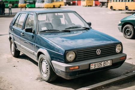 Volkswagen Golf II Hatchback Car Parked In Street. Golf Mk2 Is A