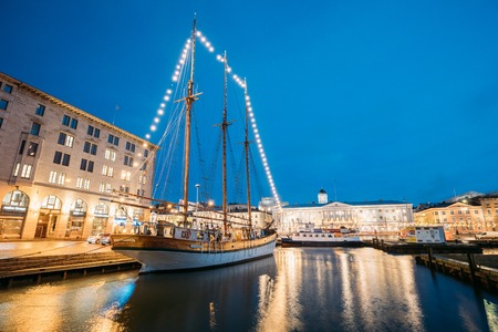 Helsinki, Finland. Old Wooden Sailing Vessel Ship Is Moored To The City Pier, Jetty. Editorial