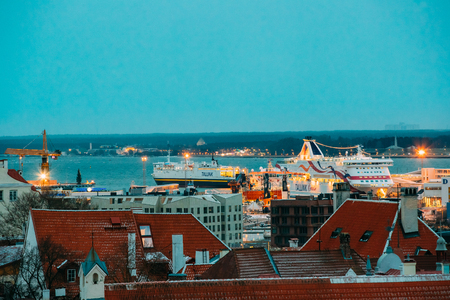 Tallinn, Estonia - December 3, 2016: Modern Ferry Ferryboat Tallinnk At Pier Awaiting Loading Cargo From Port And Passenger Boarding From Terminal. View From Old Town In Evening Or Night Illumination