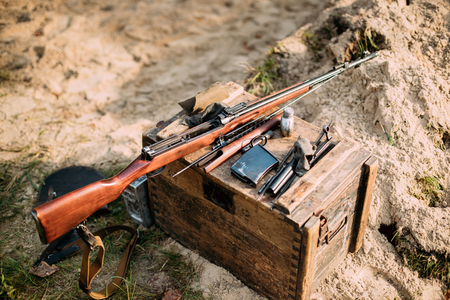 Old Soviet Russian Disassembled Sks Semi-automatic Carbine On A Wooden Box Stock Photo