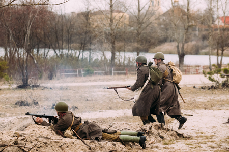 Re-enactors Dressed As Red Army Russian Soldiers Of WWII Running