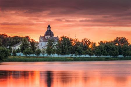 Nesvizh, Minsk Region, Belarus. Corpus Christi Church And Castle Stock Photo