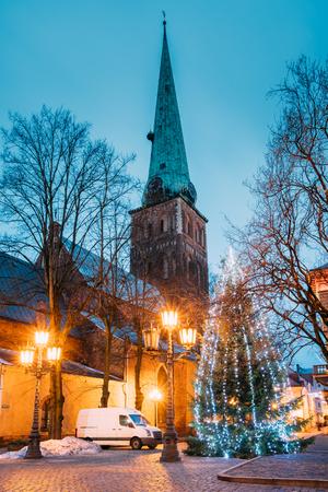 st jamess: Riga, Latvia. St Jamess Cathedral Basilica And Holiday Xmas Christmas Stock Photo