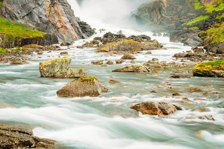 hardanger: Beautiful Waterfall In The Valley Of Waterfalls In Norway.
