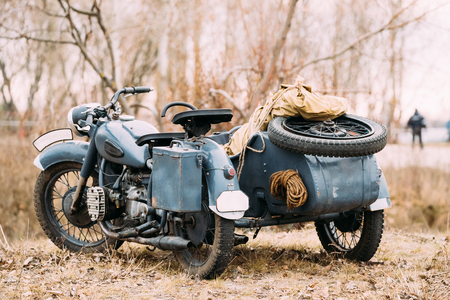 A rare Three-Wheeled Motorcycle With Sidecar Of German Forces.