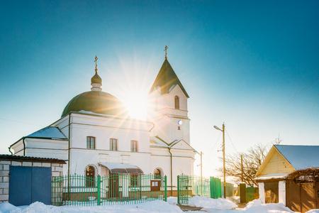 nikolay: Gomel, Belarus. Sun Shining Over Church Of St Nicholas The Wonderworker In Sunny Winter Day. Stock Photo