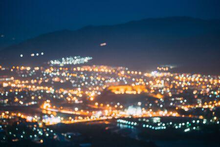 Gori, Shida Kartli Region, Georgia. Absract Blurred Bokeh Architectural Urban Backdrop. Real Blurred Colorful Bokeh Background With Defocused Lights
