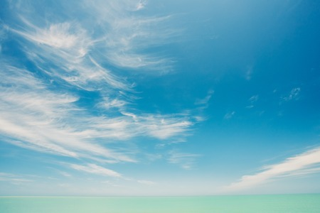 Sunny Sky Over Calm Water Of Sea Or Ocean. Natural Landscape Background With Gently Blue Colors.