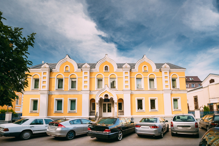 Brest, Belarus. Cars Parking Near Building Of Sunday School At St. Nicholas Church Sovietskaya Street.