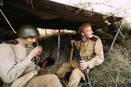 Two Reenactors Dressed As Russian Soviet Red Army Soldiers Of World War II