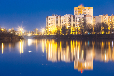 residential construction: Night View Of Urban Residential Area Overlooks To City Lake Or River Park