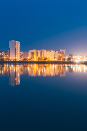 residential construction: Night View Of Urban Residential Area Overlooks To City Lake Or River And Park In Evening Illumination,