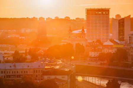 Vilnius, Lithuania. Sunset Sunrise Dawn Over Cityscape. Church O Фото со стока