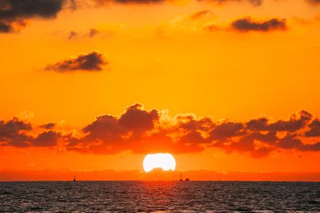 Sundown Over Sea Horizon At Sunset. Natural Sunrise Sky Warm Colors Imagens