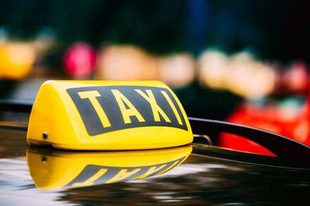 Taxi Sign On Roof Of Car Stock Photo