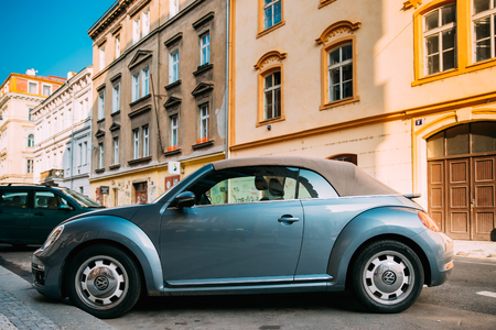 Side View Of Blue Volkswagen New Beetle Cabriolet Car Parked