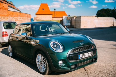 Vilnius, Lithuania. Green Color Mini Cooper Car Parking Near Bastion Editorial