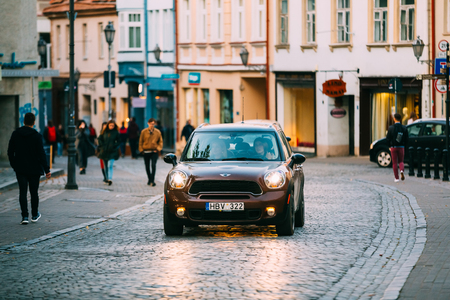 Vilnius, Lithuania. Front View Of Brown Color Car Mini Cooper Moving 新聞圖片