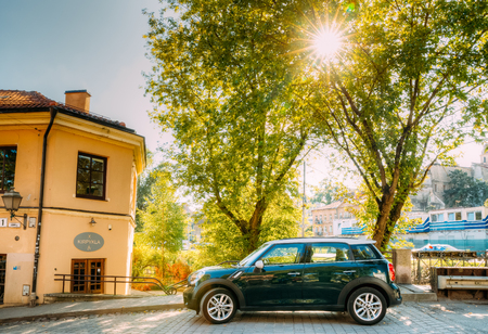 Vilnius, Lithuania. Green Color Mini Cooper Car Parking At Street