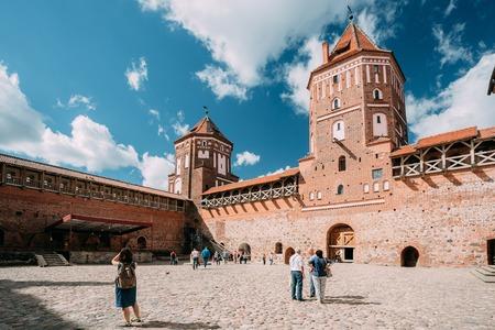 Mir, Belarus. People Walking In Courtyard Of Castle. Architectural Ensemble Of Feudalism