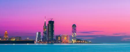 Batumi, Adjara, Georgia. Panorama of Illuminated Resort Town at Sunset Stock Photo