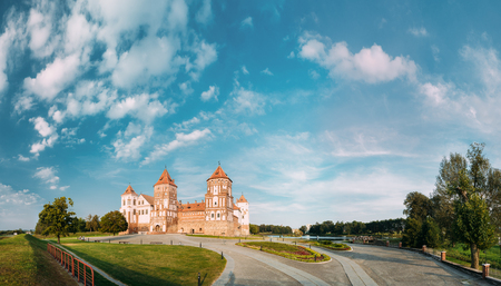 Mir, Belarus. Panorama Of Old Towers Of Mir Castle Complex On Blue Sunny Sunset Sky Background. Architectural Ensemble Of Feudalism, Cultural Monument Stock Photo